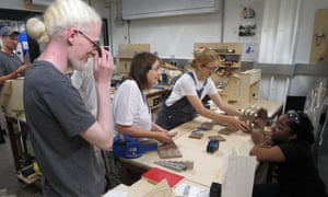 Blind and visually impaired students discussing their work with blind tutor Mandy Redvers-Rowe