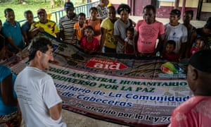Cabeceras villagers unfurl their peace banner, which they hope will mark a turning point in the community's fortunes.