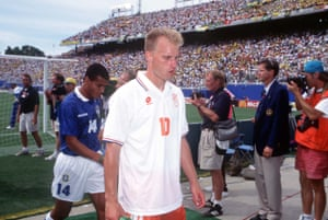 Dennis Bergkamp walks dejectedly off the pitch at the end of the match