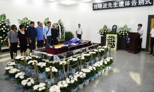 Funeral ceremony for Liu Xiaobo, who died on Thursday of liver cancer at 61. His wife, Liu Xia, is on the right, wearing sunglasses.