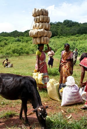 Heavy loadA woman carrying a very head load to market. Taken in Chhattisgarh, India Photograph: Onlyest/GuardianWitness