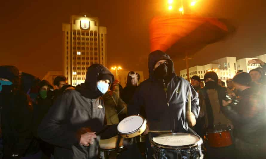 People protest in Minsk against a tax on those who work fewer than six months a year.