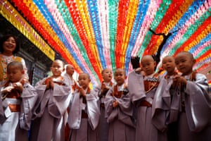 Novice monks in Seoul, South Korea, leave after an event to celebrate the forthcoming Vesak, the birthday of Buddha