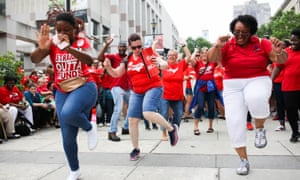 Teachers dance during a protest outside the state capitol in Raleigh, North Carolina