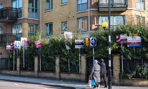Block of flats in Hackney with lots of to let and for sale signs outside