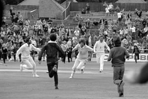 England players Graham Gooch, Bob Willis and Mike Gatting run from the pitch after England had won the 3rd Test match between England and Australia at Headingley, Leeds, 21st July 1981.