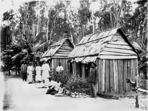 Group of South Sea Islander labourers outside their bark hut dwellings, Queensland, date unknown.