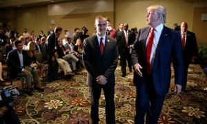 Republican presidential candidate Donald Trump walks with his campaign manager Corey Lewandowski, left, after speaking at a news conference in Dubuque, Iowa.