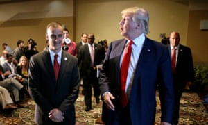 Donald Trump with his campaign manager Corey Lewandowski, who is accused of 'yanking' reporter Michelle Fields away from the candidate.