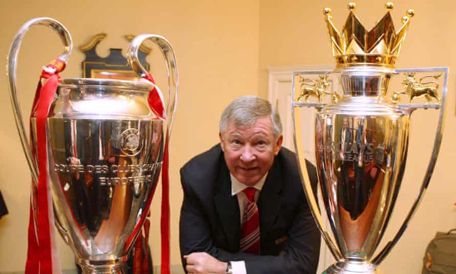 Sir Alex Ferguson with the UEFA Champions League trophy and the FA Barclays Premier League trophy in 2008