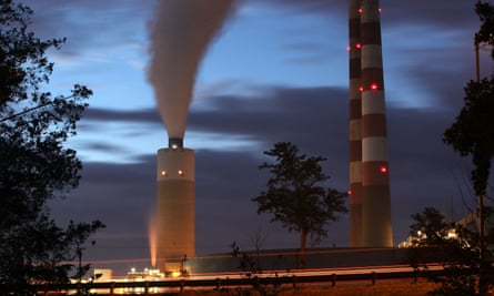 Emissions spew out of a large stack at the coal-fired Morgantown Generating Station on 10 October 2017 in Newburg, Maryland.