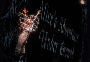 The opening scene features Alice falling down the rabbit hole