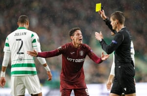 Cluj's Mario Rondon is shown a yellow card by referee Daniel Siebert for his am-dram efforts.
