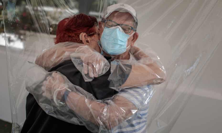 Relatives embrace through plastic deviceepa08490430 A woman (L) embraces her nephew (R) through a plastic device after three months without a hug at a home for the elderly in Valencia, Spain, 17 June 2020, amid the ongoing coronavirus pandemic. EPA/BIEL ALINO