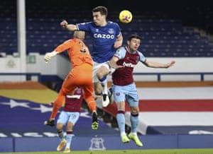 West Ham's goalkeeper Darren Randolph bats the ball clear away from Everton's Seamus Coleman.