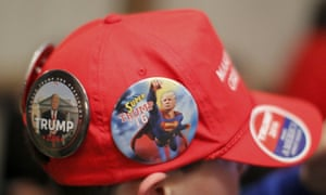 a donald trump supporters baseball cap covered in badges