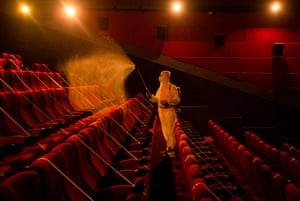 Worker disinfects cinema seats