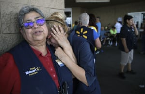 Employees stand outside the El Paso Walmart in August where a shooter killed 22 people.