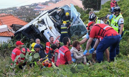 Firemen help victims of the crash on the Portuguese island of Madeira