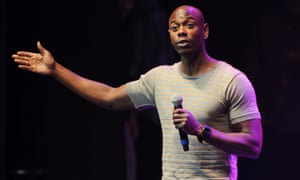 Dave Chappelle performing on stage