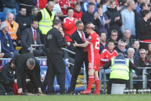 Giggs congratulates James as he leaves the pitch.