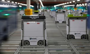 "Robots operating on the grid of the ""smart platform"" at the Ocado CFC (Customer Fulfilment Centre) in Andover."