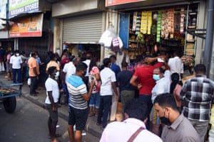 People shop for essential goods after Sri Lankan authorities the 10-day lockdown