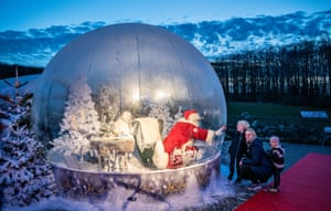 Aalborg, DenmarkSanta Claus in a life size snow ball made of plastic as a safety measure against coronavirus in Aalborg zoo. Christmas decorations and lightings have adorned Aalborg zoo, but in order to follow coronavirus restrictive and safety measures Santa Claus was put in a life size snow ball made of plastic to greet the kids without worrying about infections