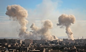 Smoke rises from buildings following bombardment on the village of Mesraba in the rebel-held besieged eastern Ghouta region.