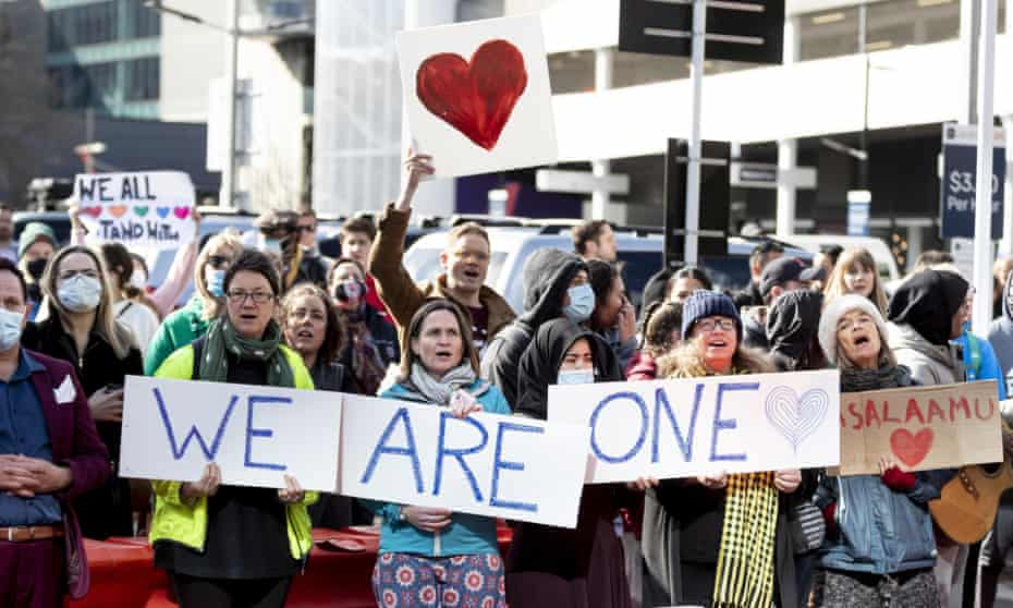 Crowds support the victims of the Christchurch mosque attacks outside the high court where the gunman was sentenced to life without parole.