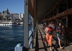 Tourists walk under the Galata Bridge on a sunny day, amid the ongoing coronavirus pandemic in Istanbul, Turkey, 15 August 2020. Turkish authorities have now allowed the reopening of restaurants, cafes, parks and beaches, as well as lifting the ban on inter-city travel, as the country eases the restrictions it had imposed in a bid to stem the spread of the ongoing pandemic.
