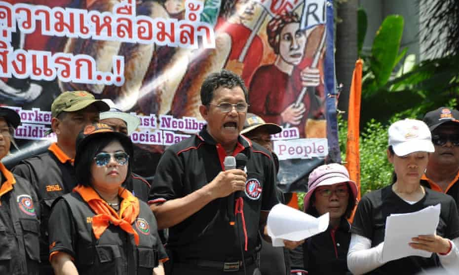 Sawit Kaewvarn, president of the rail workers' union in Thailand, speaking at a union rally
