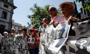 Protesters hold pictures of victims during a demonstration calling for the exhumation of Spanish dictator Francisco Franco.