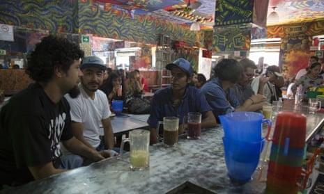 Customers at the bar at Las Duelistas pulqueria in Mexico City