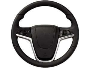 Close up image of modern steering wheel.