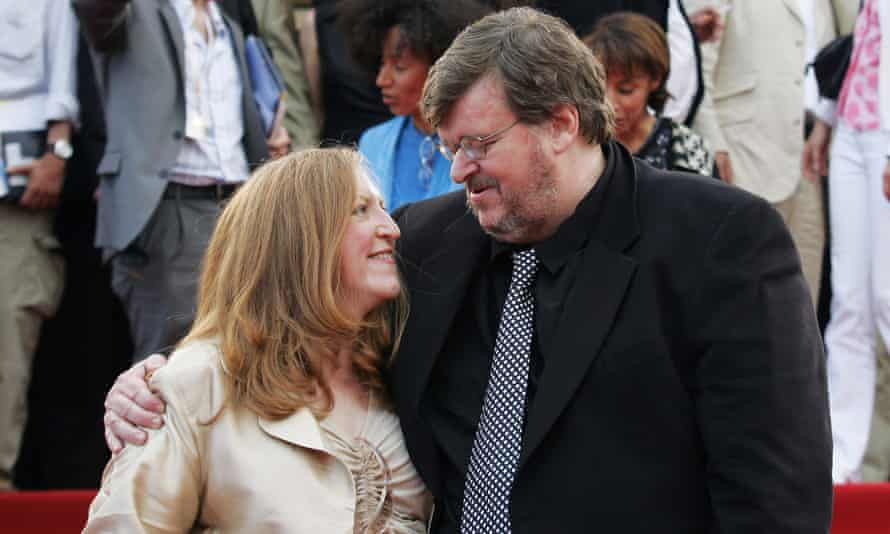 Moore and producer Kathleen Glynn, whom he recently divorced after 22 years, at the Cannes festival in 2004.