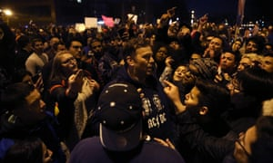 Trump supporters and protesters clash outside the venue