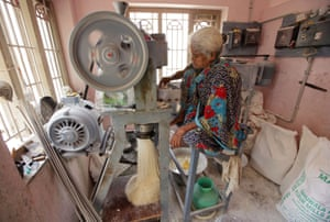 A woman makes vermicelli in Chennai, India