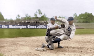 Detroit Tigers' Harry Heilmann is tagged out by Washington Senators' third baseman Howard Shanks at Griffith Stadium on 8 June 1921.