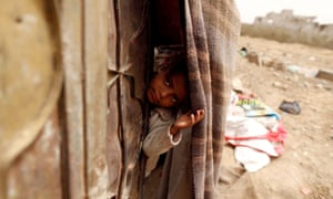Sana'a, YemenA girl displaced from the Red Sea port city of Hodeidah looks out from behind the door of her family shelter