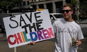 A demonstrator wears a T-shirt with a QAnon slogan in New York. The 'Save Our Children' version of the conspiracy theory offers a decidedly softer aesthetic and rhetorical appeal.