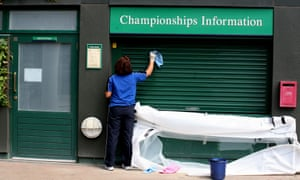 A cleaner at work, at the All England Lawn Tennis Club in Wimbledon.