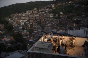 Rio de Janeiro, Brazil: members of the Tempero de Criola band perform at the Turano favela