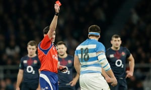 Argentina's Enrique Pieretto Heilan is shown a red card