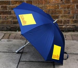 An umbrella advertising Savills estate agents.
