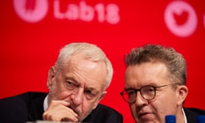Jeremy Corbyn (left) and deputy leader Tom Watson at the opening session at the party's annual conference in Liverpool.