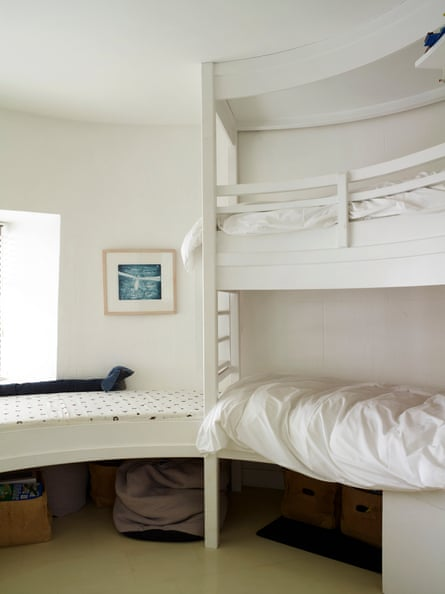 Sleep well: bunk beds built to follow the curve of the lighthouse's ancient walls.
