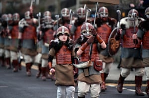 Children march through the streets of Lerwick
