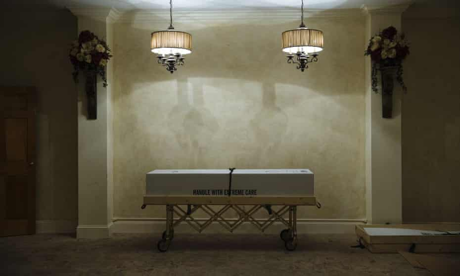 A cremation box sits in a room at a funeral home in Queens, New York, on 29 April.