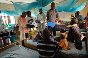 Medical staff consult with patients at the health centre